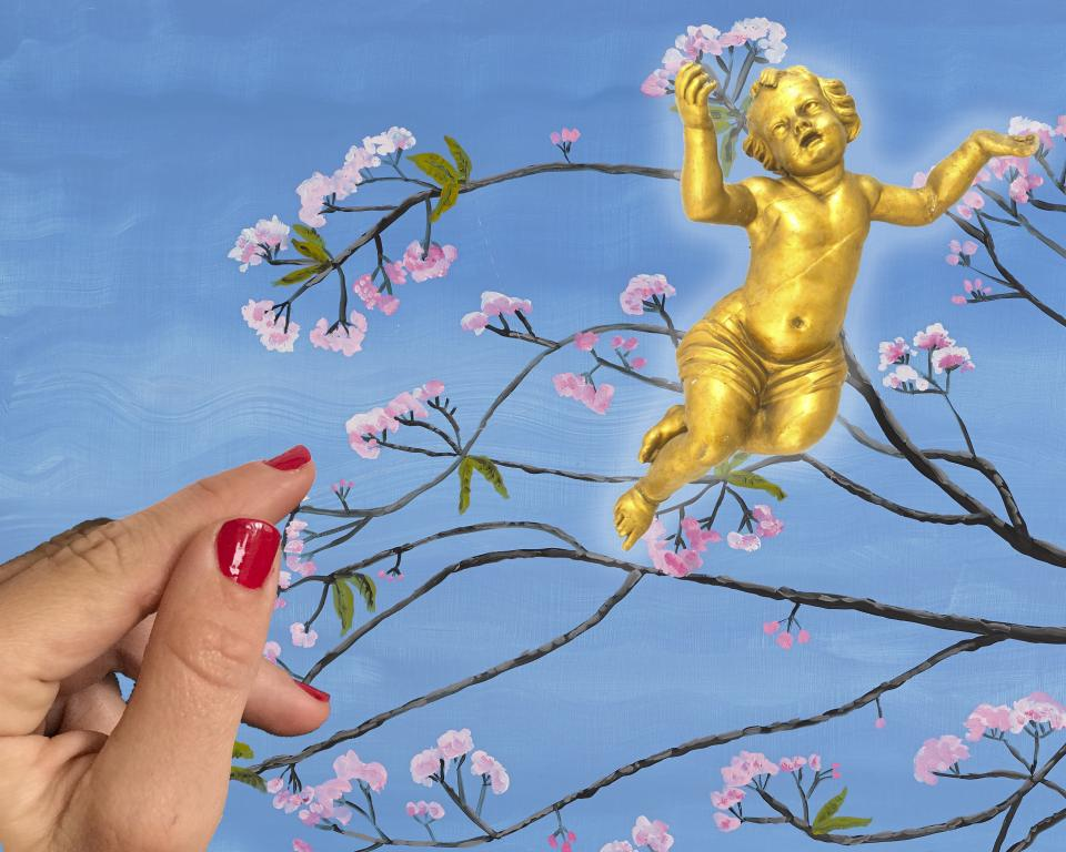 A golden cupid floats against a painting of cherry blossom branches against a blue sky, with a hand with red painted nails rests against the left of the image