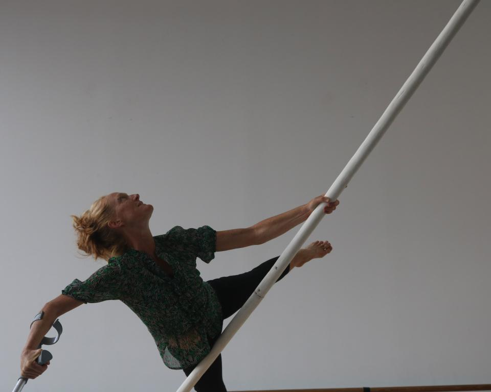 An aerial dancer with a pole