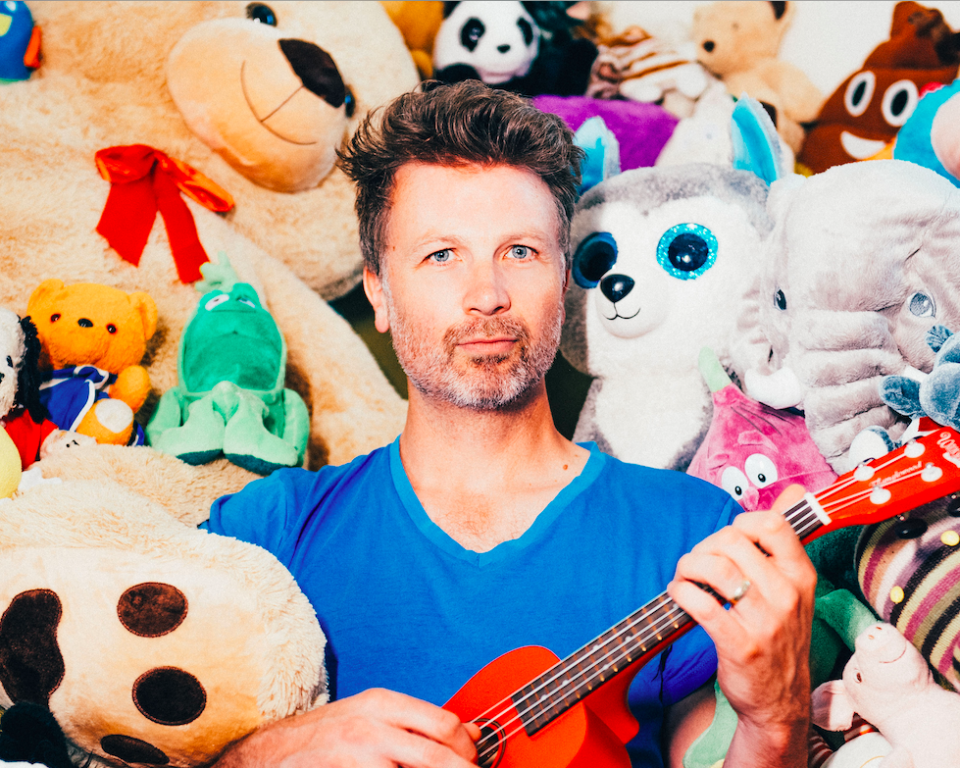 Paul Noonan Surrounded by Teddy Bears