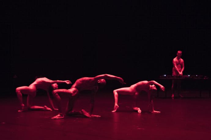 On Spirals, three dancers in red light