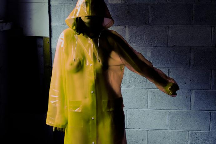 Woman in yellow hooded mac raincoat